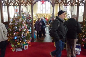 Fakenham Christmas Tree Festival, Parish Church, Fakenham, North Norfolk | Fakenham Parish Church is lit up by 90 Christmas Trees, each decorated for one of the 78 charities taking part. With Deepdale Christmas Market, this is an excellent reason to make a weekend of it at Deepdale! | fakenham, parish, church, christmas, tree, festival, north, norfolk