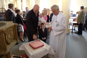 Cutting the baptism cake